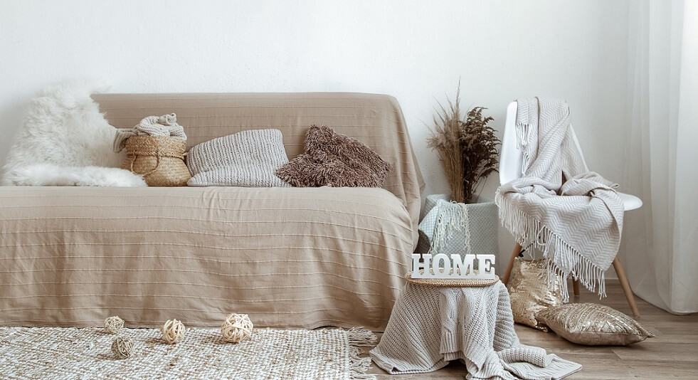 sofa with pillows and blankets