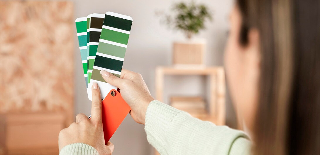 girl deciding colors for room